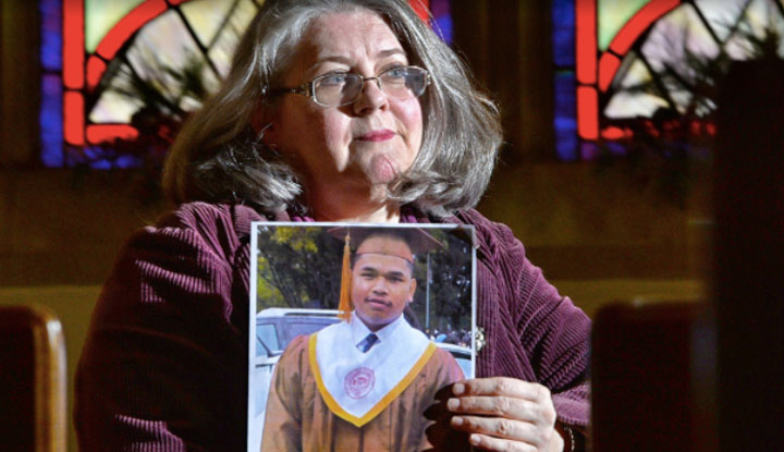 Pastor Jolin McElroy Holds Portrait of Dalin Adrong
