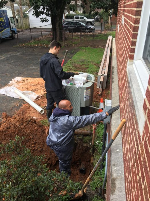 E.R. Plumbing Services installing the needed drain.